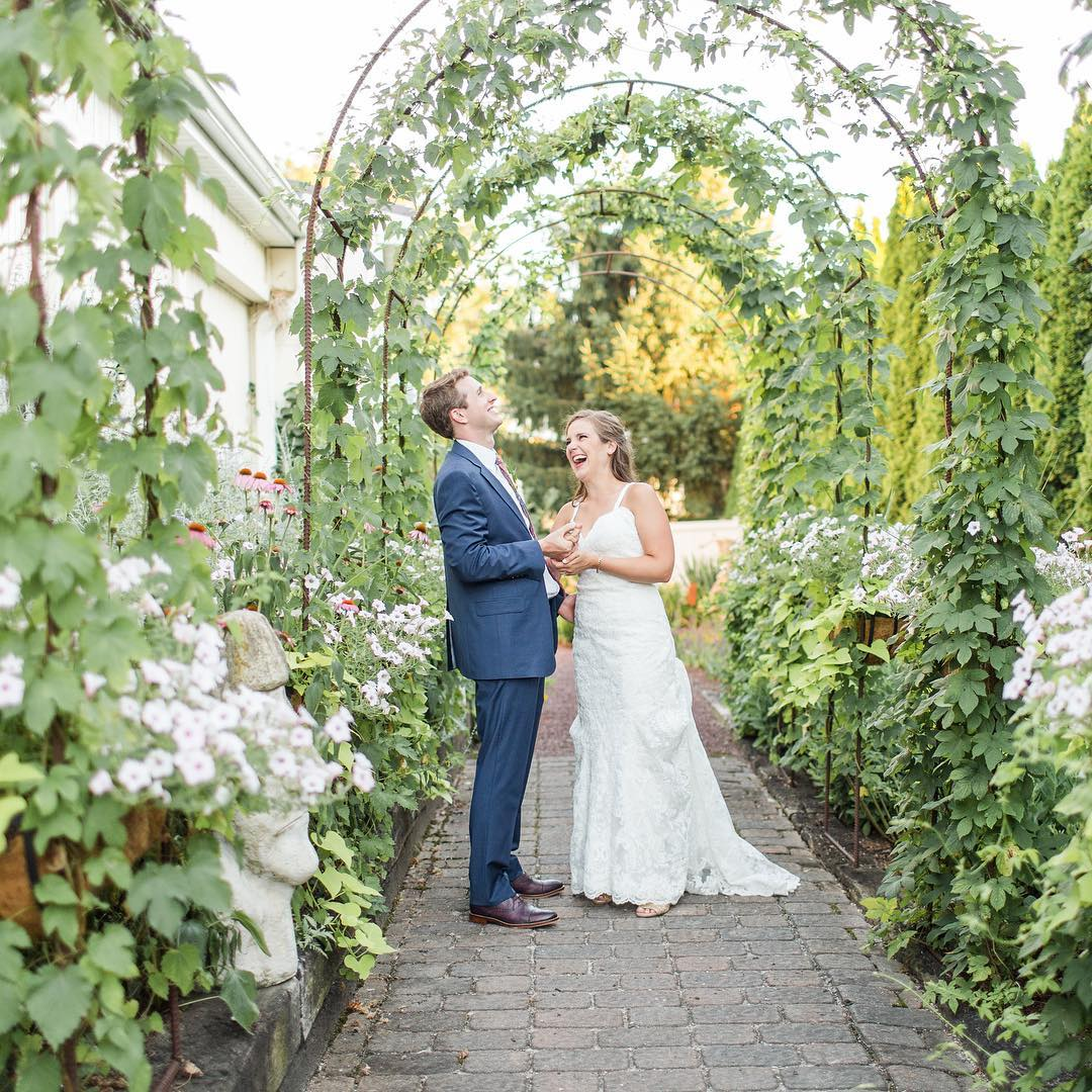 The Inn At Leola Village, A Historic Hotel of America | Leola | Wedding Couple under Garden Arch
