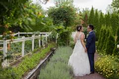 The Inn At Leola Village, A Historic Hotel of America | Leola | Wedding Couple in Chef's Garden
